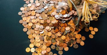 Pennies in savings jar.